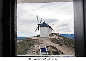 White old windmill on the hill near Consuegra (Castilla La...