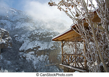 A winter panorama of Geghard Monastery, unique architectural construction and a UNESCO World Heritage in Armenia. Horizontal picture.