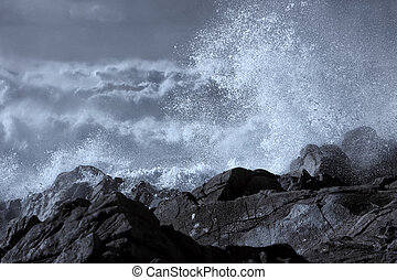 Stormy waves breaking in the coast - Stormy waves with wind...