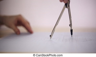 Draftsman uses the compass on a sheet of paper, she draws a...