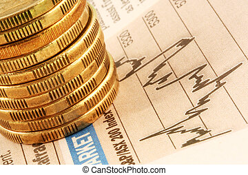 Coins on Finance Graph - A stack of gold coins on a finance...