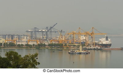 Cargo port in the work. Ha Long Bay. Vietnam. (Shot in 4K -...