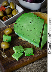 Green cheese with basil. - Green cheese with basil on wooden...
