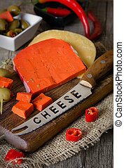 Red cheese with paprika and tomatoes. - Green cheese with...