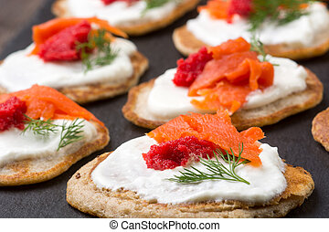 Russian buckwheat pancakes blini with cream and caviar