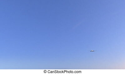 Commercial airplane arriving to Bruges airport. Travelling...