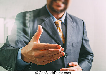businessman with an open hand ready to seal business...
