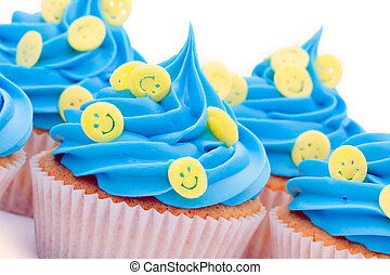 Smiley face cupcakes - Cupcakes decorated with yellow smiley...