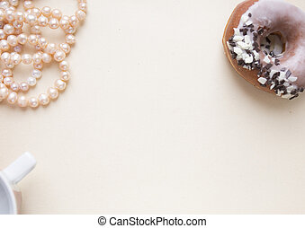 Blank craft background. Sheet of rough paper with rose pearls and donut. Mock up for letter writing, creative work concept