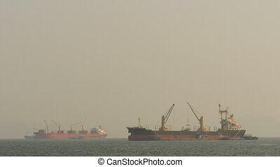 Cargo ships float in the sea. Asia. Vietnam. - Cargo ships...