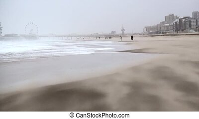 Pan from beach to the sea in strong wind. - Sandstorm by...