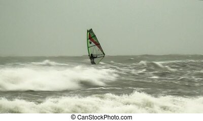 Windsurfing in high waves. - Surfing in the sea by strong...