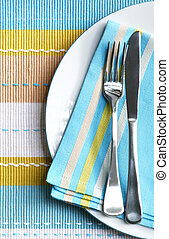 Place Setting - Place setting with silver fork and knife on...