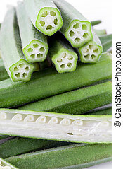 Okra pods with cut stem, whole and sectioned, vertical...