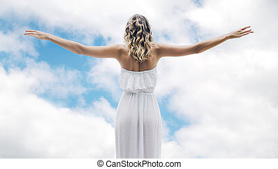 Beautiful woman flying up to the sky