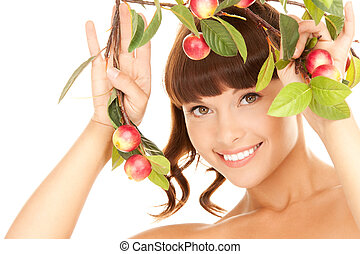 happy woman with apple twig - picture of happy woman with...