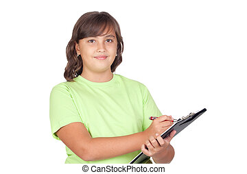 Adorable preteen girl writing on clipboard isolated on white...