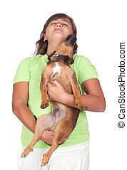 Teenage girl with her puppy isolated on white background