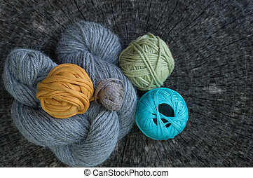 Close Up of Knitting Yarns on Tree Ring Background - Close...