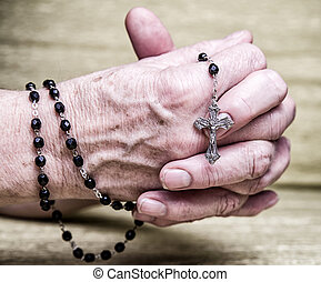 Rosary in clasped hands - Rosary in old clapsed hands...