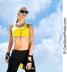 Fit, sporty and athletic young woman. Beautiful girl in a...