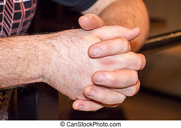 Clasped hands of men close up. Male hands