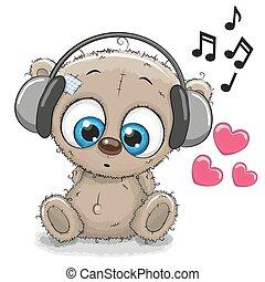 Cute cartoon Teddy Bear with headphones on a white...