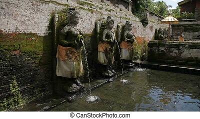 Fountains at Goa Gajah Temple (The Elephant Cave Temple). Ubud, Bali island, Indonesia.