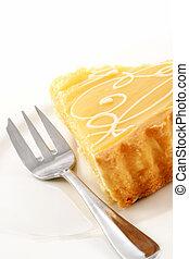 Lemon Tart - Lemon tart on a white plate, with cake fork A...