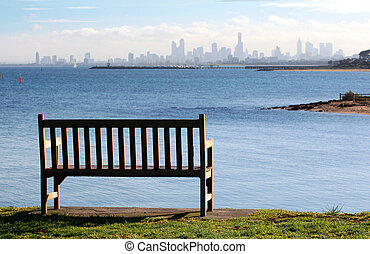 Sea View - Park bench on a clifftop, overlooking a bay with...