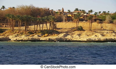 Red Sea coast with Summer beaches, Palm and hotels. Boat...