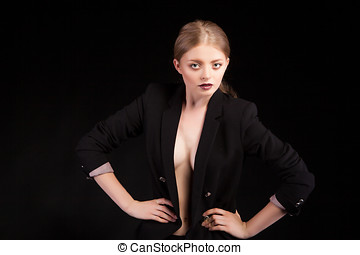 Sexy woman with no bra in fashion suit on blavk background...