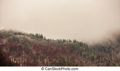 Time lapse of clouds moving in the mountains. Snow and...