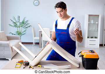 Man repairing chair in the room