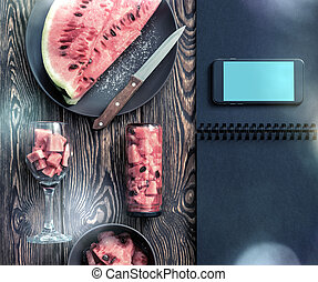 Mockup of the smartphone next to watermelon slices. Clipping...