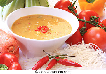 Laksa - Asian Laksa soup, surrounded by vegetables and...