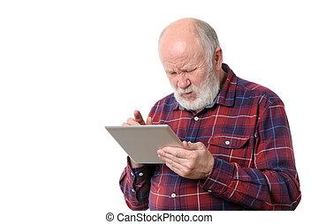 Senior man touching something at tablet computer screen,...