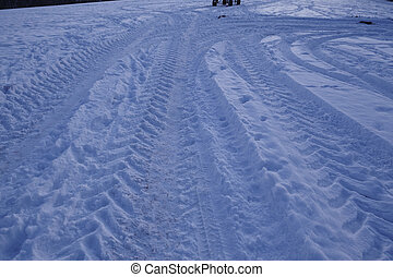 Snowscape with skid marks into the snow - Some skid marks...