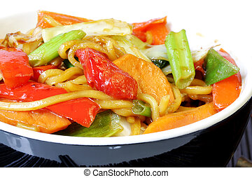 Stir-Fried - Stir-fried noodles and vegetables, in black...