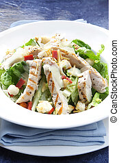 Chicken Caesar Salad - Chicken Caesar salad, on blue A...
