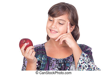 Adorable preteen girl with a apple thinking isolated on...