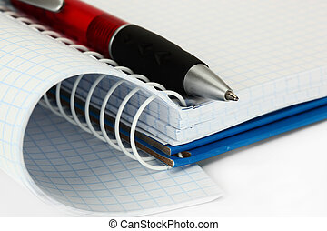 Pen notebook on white background