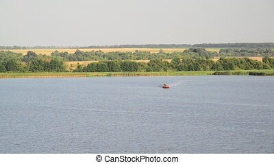 Old boat floating on river, Russia - Old boat floating on...