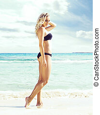 Beautiful woman in black swimsuit. Young and sporty girl...