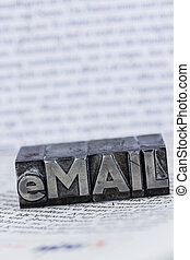 "written email in lead letters - the word ""e-mail"" in lead..."