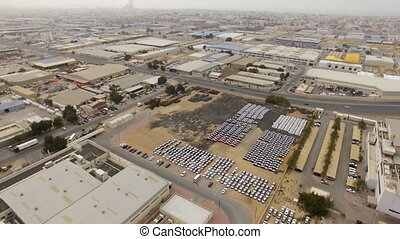 Aerial view industrial area with automotive warehouse,...