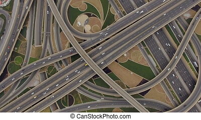 aerial view of traffic junction with cars in Dubai, UAE - On...