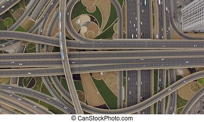 aerial view of road junction with railway tracks in Dubai,...