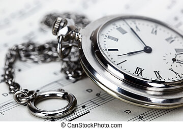 old pocket watches - Old pocket watch and music books