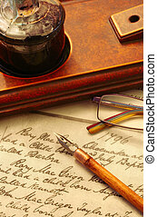 Pen and Ink - Vintage nib pen and inkwell, on page of 18th...